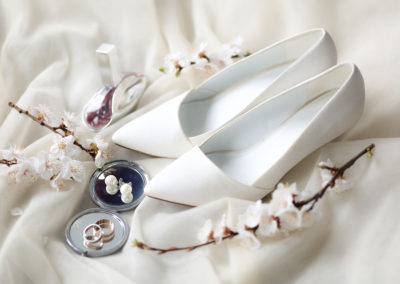 wedding rings and shoes on wedding morning of the bride
